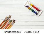 background with paintbrushes...   Shutterstock . vector #393837115