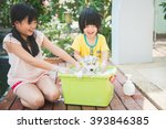 Stock photo asian children wash siberian husky puppy in the basin on the summer 393846385