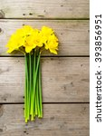 Yellow Daffodils On Wooden Table