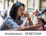 woman praying in the church.... | Shutterstock . vector #393873184