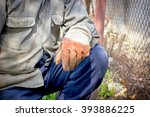 Small photo of Worker on hard work - drudgery work requires a break (concept)