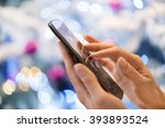 Woman Using Her Mobile Phone A...