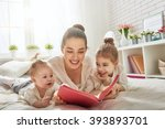 happy loving family. pretty... | Shutterstock . vector #393893701