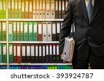 businessman holding data files... | Shutterstock . vector #393924787