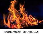 Dance Of Flames Against A Dark...