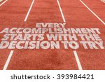 Small photo of Every Accomplishment Starts With the Decision to Try written on running track