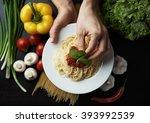 female chef decorating italian... | Shutterstock . vector #393992539