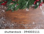 snowy fir twigs with red... | Shutterstock . vector #394003111