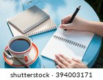 woman right hand writing... | Shutterstock . vector #394003171