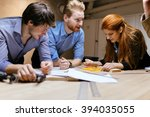 group of designers working on a ... | Shutterstock . vector #394035055