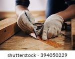 woodworker with lumber.... | Shutterstock . vector #394050229