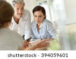 business people meeting around... | Shutterstock . vector #394059601