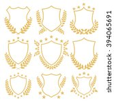 gold shields and insignias set. ... | Shutterstock .eps vector #394065691