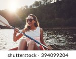 Smiling Young Woman Kayaking O...