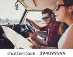 happy young couple with a map... | Shutterstock . vector #394099399