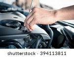 car mechanic working in the... | Shutterstock . vector #394113811