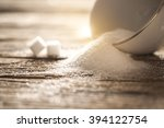 sugar in white cup on wood... | Shutterstock . vector #394122754