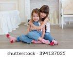 two little girls sisters hugging | Shutterstock . vector #394137025