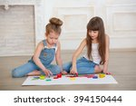 two little girls paint sitting... | Shutterstock . vector #394150444