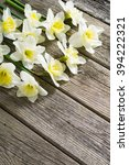 white daffodil flowers on old... | Shutterstock . vector #394222321
