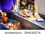 young woman putting goods on...   Shutterstock . vector #394230274