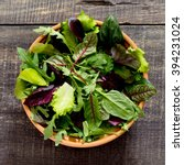 fresh green mixed salad in a... | Shutterstock . vector #394231024