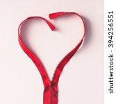red zipper in shape of a heart... | Shutterstock . vector #394256551