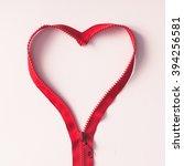 red zipper in shape of a heart... | Shutterstock . vector #394256581