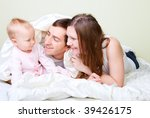 happy young parents with their... | Shutterstock . vector #39426175