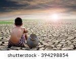 sad boy sitting on dry ground... | Shutterstock . vector #394298854