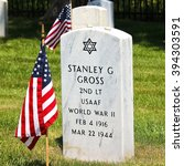 Small photo of Lake Forest, IL, USA - May 23, 2015: Memorial Day (Decoration Day) weekend view of an American flag at the Fort Sheridan Cemetery tombstone of a World War II U.S. Army Air Force 2nd Lieutenant.