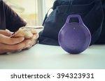 woman using bluetooth speaker... | Shutterstock . vector #394323931