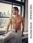 shirtless muscular man posing... | Shutterstock . vector #394342381
