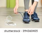 Woman Tying Up Running Shoe
