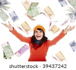 Girl in autumn orange sweater, hat  with flying money euro.Isolated. - stock photo
