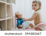cute baby girl playing in a... | Shutterstock . vector #394383367