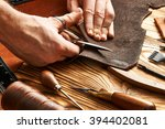 man working with leather using... | Shutterstock . vector #394402081