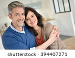 middle aged couple embracing... | Shutterstock . vector #394407271