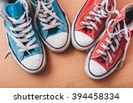 blue sneakers and red sneaker... | Shutterstock . vector #394458334