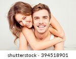 cheerful smiling couple in love ... | Shutterstock . vector #394518901