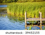 photo of a wooden pier on a lake - stock photo