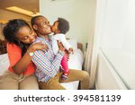 adorable african family at home | Shutterstock . vector #394581139