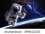 astronaut in outer space.... | Shutterstock . vector #394612231
