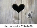 the wooden door with heart - stock photo