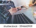 two colleagues website designer ... | Shutterstock . vector #394660909