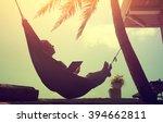 woman an using a digital tablet ... | Shutterstock . vector #394662811