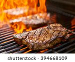 grilling new york strip steaks... | Shutterstock . vector #394668109