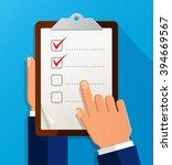 businessman holding checklist.... | Shutterstock .eps vector #394669567