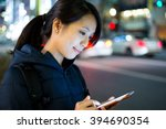 Woman Sending Text Message On...