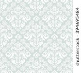 damask seamless light blue and... | Shutterstock . vector #394695484